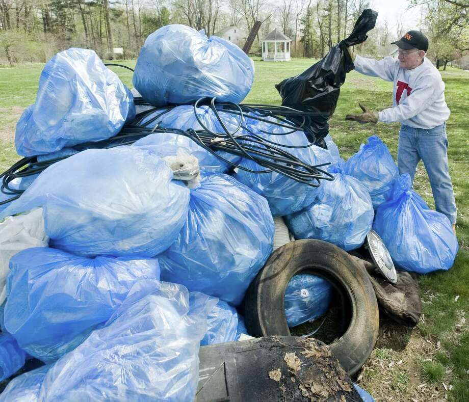 Redding                   The effort to build Mt. Trashmore on the town green  returns from 9 a.m. to 3 p.m. on Saturday. Volunteers will start at Town  Hall to get trash bags, gloves, vests and road assignments, which will  be given out until 1 p.m. Litter can be turned in on the green until  2:45 p.m. There will be a photo in front of the pile before the bags are  put in dumpsters and brought to the transfer station. Volunteers will  receive a Popsicle or Fudgsicle at the end.                                                                 Anyone who can't attend can join the international effort  by including the hashtag #trashtag on social media posts for events  that feature before and after pictures of litter collection efforts. Photo: Scott Mullin / For The / The News-Times Freelance