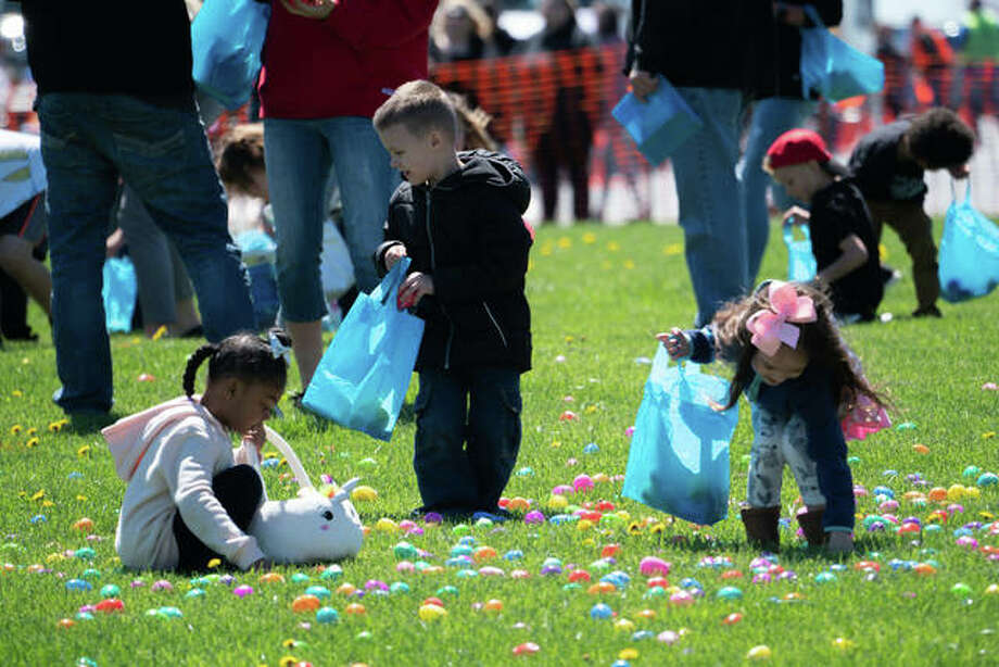 Kids scurry about collecting colorful eggs at Metro Community Church's Easter Egg Drop Saturday in Edwardsville. The event, originally set on April 14, was rescheduled due to weather concerns but still drew crowds of attendees from around the Metro East. Photo: Breanna Booker | The Intelligencer