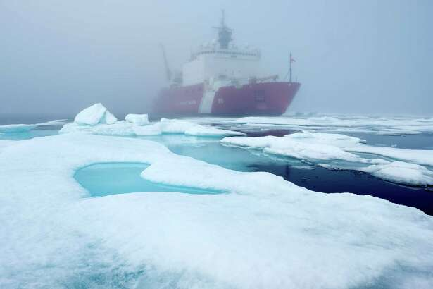 Ice floes and fog surround the U.S. Coast Guard Cutter Healy in the Arctic Ocean on July 29, 2017. The cutter is the largest icebreaker in the Coast Guard and serves as a platform for scientific reseach.
