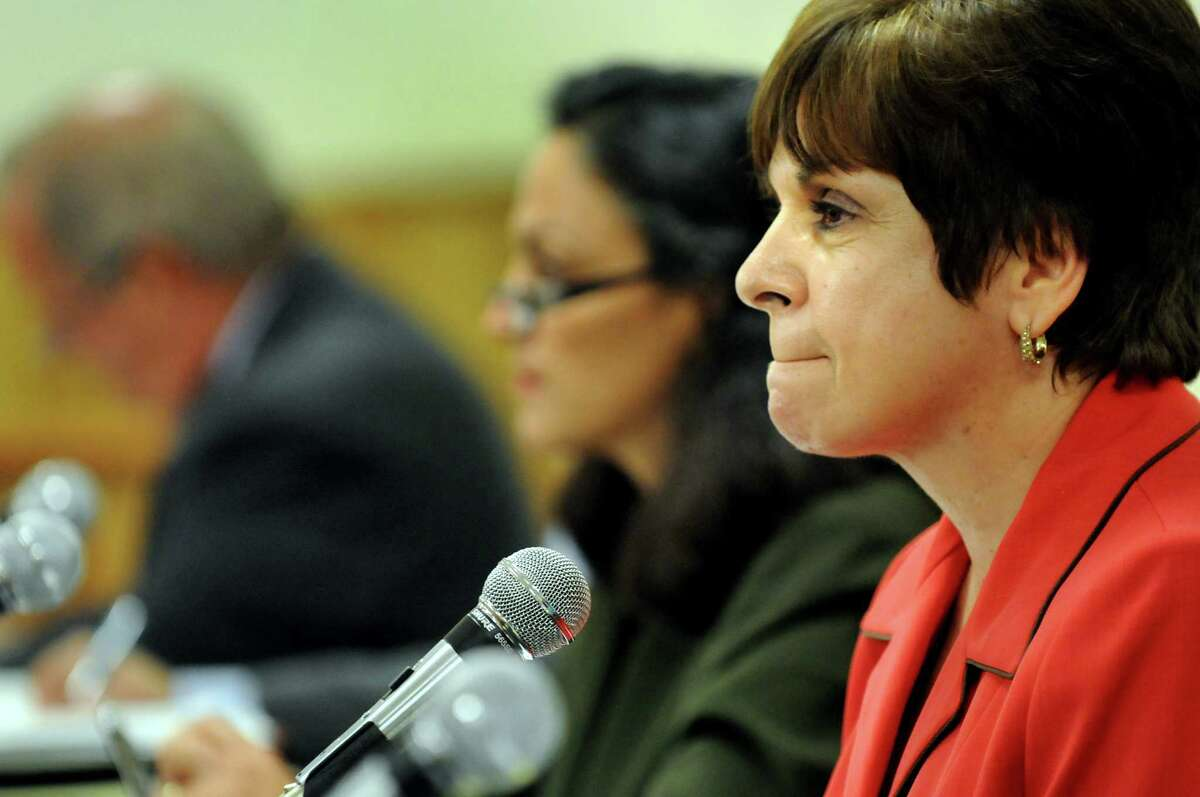 Town Supervisor Paula Mahan, right, and the town board take questions and comments during a public hearing in this file photo from 2011 at Colonie Town Hall in Colonie, N.Y. (Cindy Schultz / Times Union)