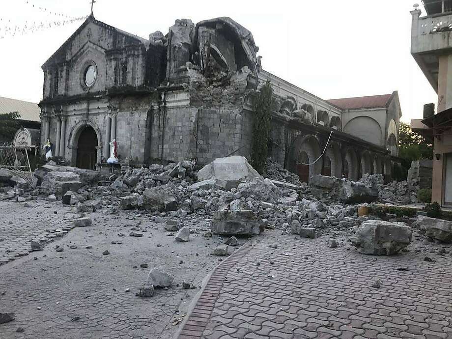 The St. Catherine church is damaged after an earthquake struck Porac town, Pampanga province, northern Philippines Monday, April 22, 2019. A strong 6.1 magnitude earthquake in the north Philippines on Monday trapped some people in a collapsed building, damaged an airport terminal and knocked out power in at least one province, officials said. (AP Photo/Vhic Y Naluz) Photo: Vhic Y. Naluz, Associated Press