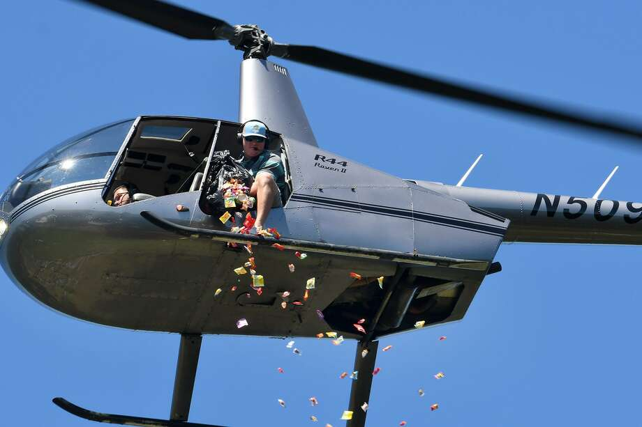 Loose candy and small toys are dropped from a helicopter during the Easter Egg Drop at Salem Lutheran Church & School in Tomball on Saturday. Photo: Jerry Baker, Houston Chronicle / Contributor / Houston Chronicle