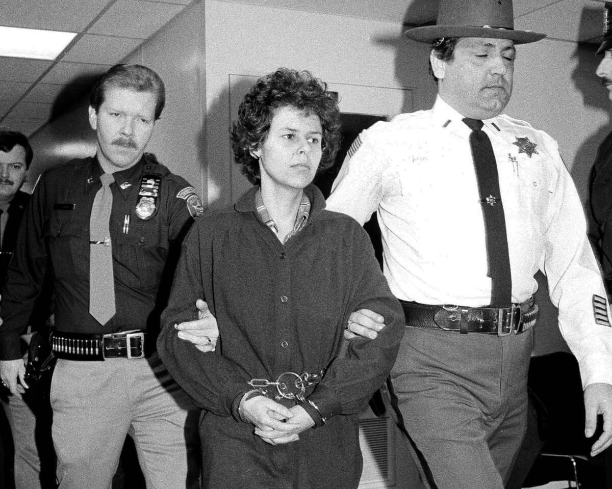 In this Nov. 24, 1981 file photo, Weather Underground member Judith Clark is escorted into Rockland County Courthouse in New City, N.Y. Clark was granted parole last weekl, April 17, 2019, after serving more than 37 years behind bars for her role as getaway driver in a 1981 Brink's armored truck robbery that left two police officers and a security guard dead. (AP Photo/David Handschuh, File)