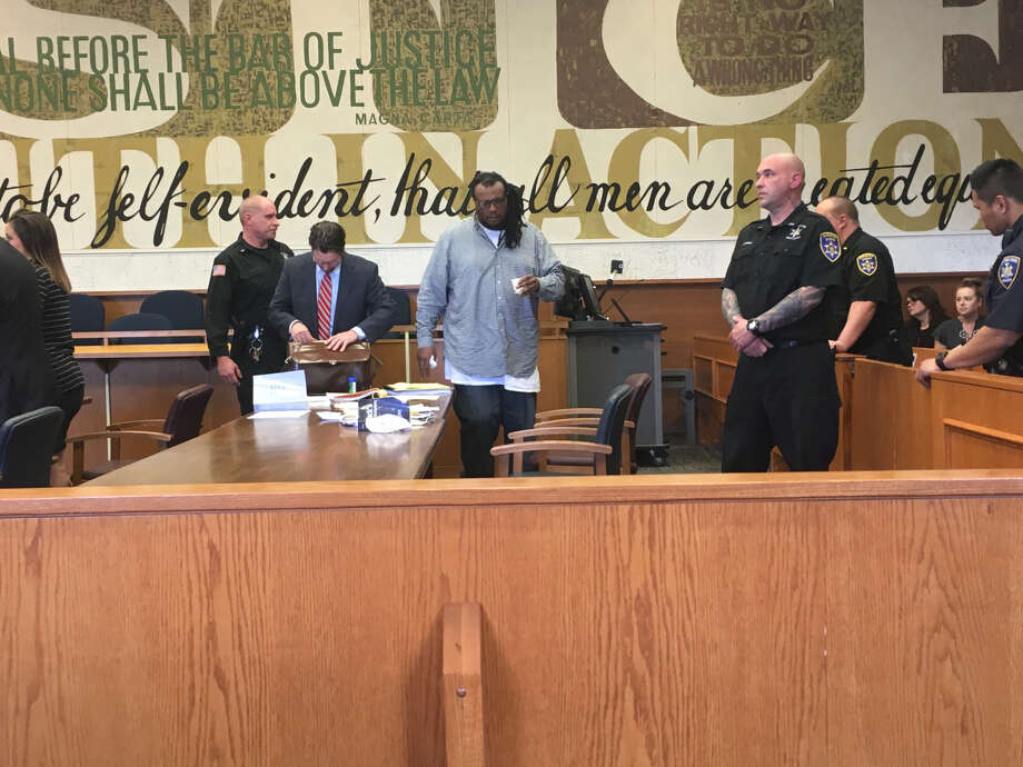 Dushawn Howard leaves the stand after testifying Monday morning at his attempted murder trial. Howard insisted that his estranged girlfriend fired that shots that left her, her daughter and her son with gunshot wounds. Photo: Paul Nelson / Times Union