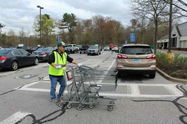 A Stop & Shop employee returns to work in Norwalk on Monday after the grocery giant and unions came to an agreement that ended an 11-day strike.
