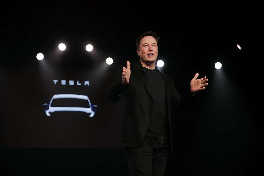 FILE- In this March 14, 2019, file photo Tesla CEO Elon Musk speaks before unveiling the Model Y at Tesla's design studio in Hawthorne, Calif. Musk appears poised to transform the company's electric cars into driverless vehicles in a risky bid to realize a bold vision that he has been floating for years. The technology required to make that quantum leap is scheduled to be shown off to Tesla investors Monday, April 22, 2019, at the company's Palo Alto, Calif., headquarters. (AP Photo/Jae C. Hong, File) Photo: Jae C. Hong, Associated Press