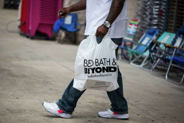A customer carries a shopping bag outside a Bed Bath & Beyond Inc. store in Charlotte, N.C., on June 25, 2018.