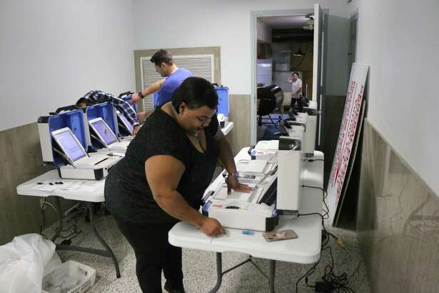 Liberty County Clerk staff unpack and test their new elections equipment recently shipped to the county courthouse in time for the May 2019 election.