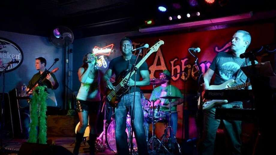 Dr. Soham Roy plays the bass guitar not only because he enjoys it but also because it helps him burn off steam from his stressful job as a pediatric ear, nose and throat surgeon. Here, Gary Hawkins (pictured left to right), Kim Price, Roy, JR Martinez and Doug Konopik perform together as the Voodoo Dolls at The Abbey Pub in Houston. Photo: Courtesy Photo
