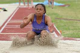Anaiya Midget of Ridge Point competes in the long jump competition during the District 19/20, Region III-6A Area Track & Field Meet on Thursday, April 18, at the Paetow High School in Katy.