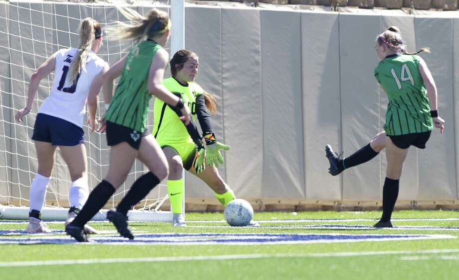 Southlake Carroll forward Madison Drenowatz (14) gets a shot past Katy Tompkins goalie Rebekah Jordan (00) in the first period of the Class 6A girls state championship match during the UIL State Soccer Championships at Birkelbach Field on Saturday, April 20, in Georgetown. Photo: Jason Fochtman, Houston Chronicle / Staff Photographer / © 2019 Houston Chronicle