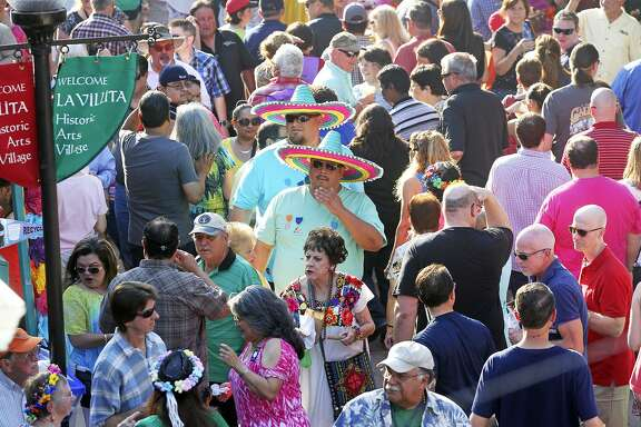 Crowds like this one, during the 2014 A Night in Old San Antonio, are the most commonly cited reason why people stay away from Fiesta events.