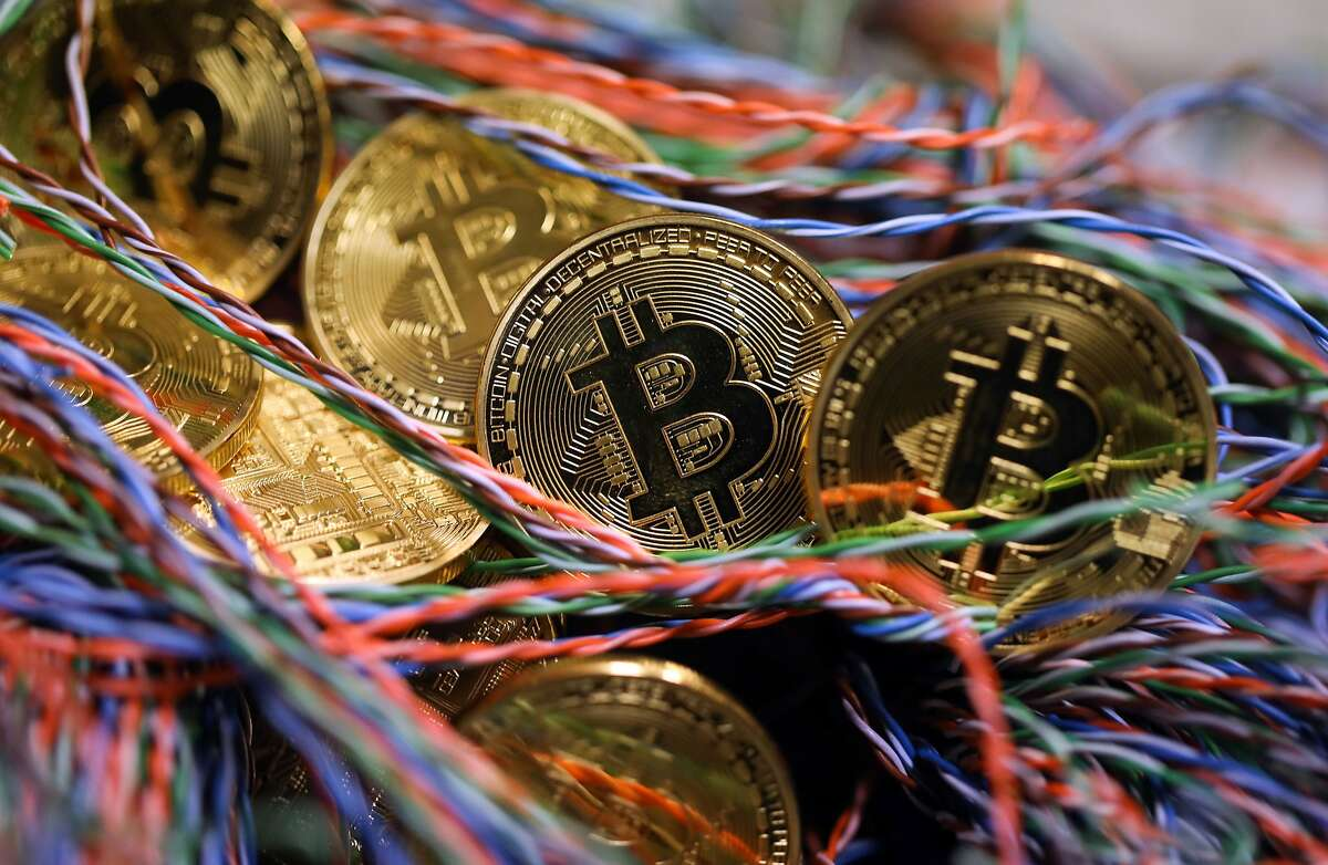 Bitcoin lives on the internet, not as physical currency but that hasn't stopped traders from driving up the cryptocurrency's value. MUST CREDIT: Bloomberg photo by Chris Ratcliffe.