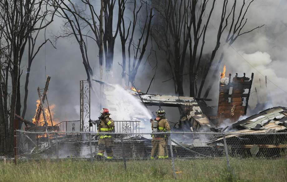 Firefighters work to control a fire at 200 Beldon Avenue involving SWAT team members on April 16, 2019. Photo: Tom Reel/Staff Photographer