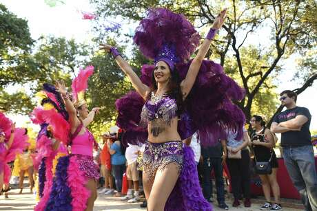Members of the Samba Vida Drum & Dance Co. parade through Hemisfair Park during the Fiesta Fiesta event on Thursday, April 18, 2019. The event is the official opening of Fiesta.