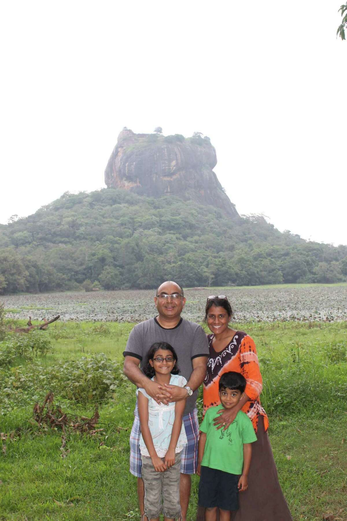 Guilderland resident Fazana Saleem-Ismail with her family in front of Sigiriya Rock, an ancient rock fortress and UNESCO world heritage site in Sri Lanka, her parents' birth country in an undated photo.