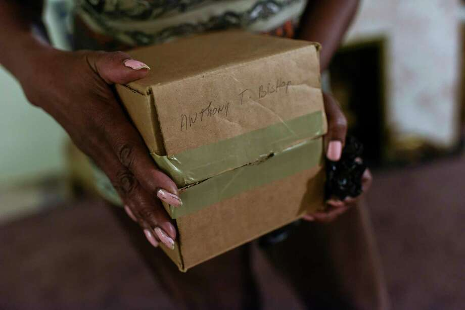 """Electa Thompson holds a cardboard box bearing the name of her grandson, Anthony Bishop, whose ashes she was told were in the box. """"I don't want to think that's not him,"""" said Bishop's mother, Yolanda Green. Photo: Washington Post Photo By Michael Robinson Chavez. / The Washington Post"""