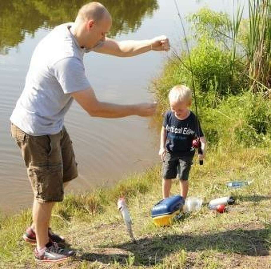 At the fifth annual Friendswood Youth Fishing Derby on May 11, children will compete to catch the largest catfish in the Centennial Park, pond. / Internal
