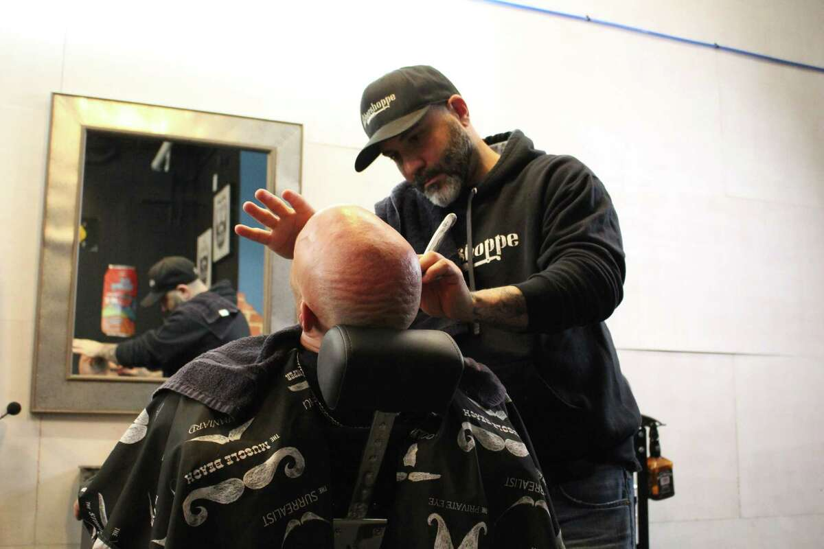 Owner Ralph Bonadio gives a customers a hot towel shave.
