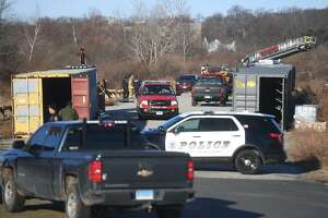 Milford firefighters and police are on scene for a storage container fire at Silver Sands State Park in Milford, Conn. on Sunday, March 24, 2019.