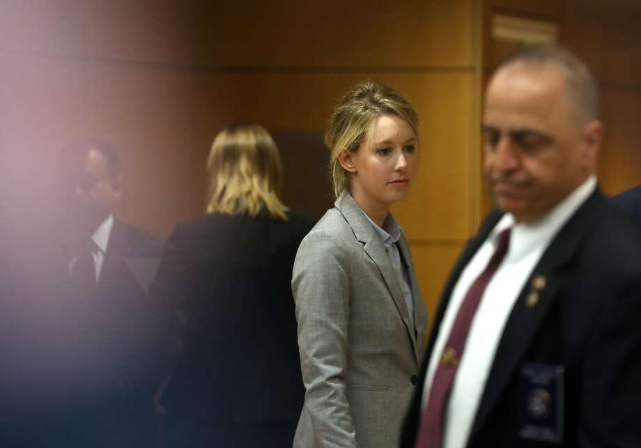 Former Theranos founder and CEO Elizabeth Holmes arrives at the Robert F. Peckham U.S. Federal Court on April 22, 2019 in San Jose, California. Former Theranos CEO Elizabeth Holmes and former COO Ramesh Balwani appeared in federal court for a status hearing. Both are facing charges of conspiracy and wire fraud for allegedly engaging in a multimillion-dollar scheme to defraud investors with the Theranos blood testing lab services. Photo: Justin Sullivan, Getty Images