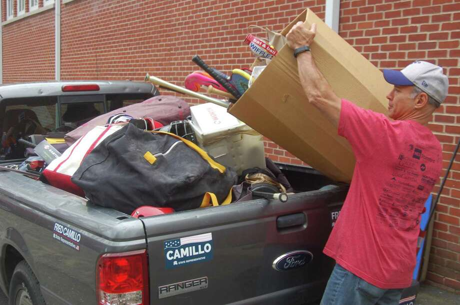 State Rep. Fred Camillo brings a huge haul of donated sports equipment from people all over town to the Boys & Girls Club of Greenwich on Monday, April 22, 2019. Photo: Ken Borsuk / Hearst Connecticut Media