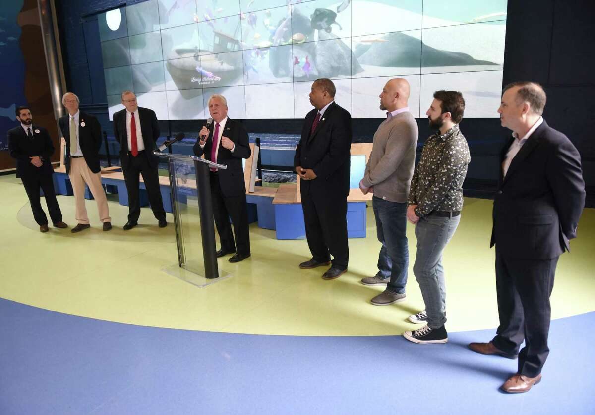 Norwalk Mayor Harry Rilling, center, speaks during an Earth Day initiative press conference at the Martime Aquarium in Norwalk, Conn. Monday, April 22, 2019. Stamford and Norwalk leaders announced a plan to ban the use of single-use plastic straws and urged local businesses and residents to use more eco-friendly materials when possible.
