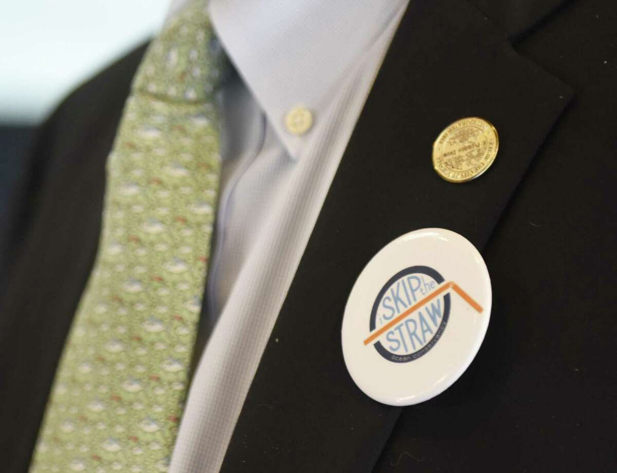 Norwalk Common Council President Tom Livingston wears a