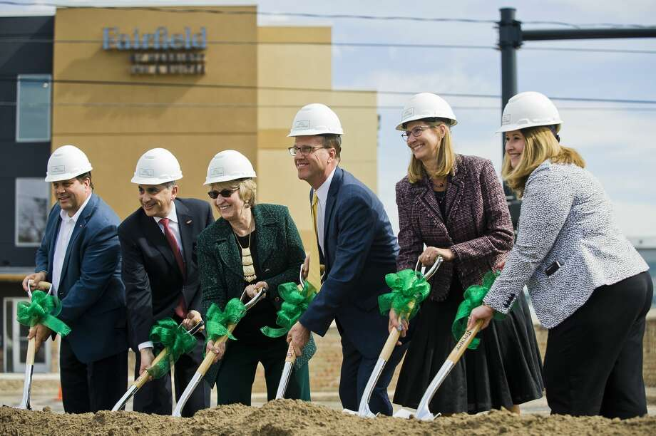 Delta College President Dr. Jean Goodnow, third from left, breaks ground on Delta's Midland campus alongside partners in the project during a ceremony on Monday, April 22, 2019 at 419 E. Ellsworth Street in Midland. (Katy Kildee/kkildee@mdn.net) Photo: (Katy Kildee/kkildee@mdn.net)