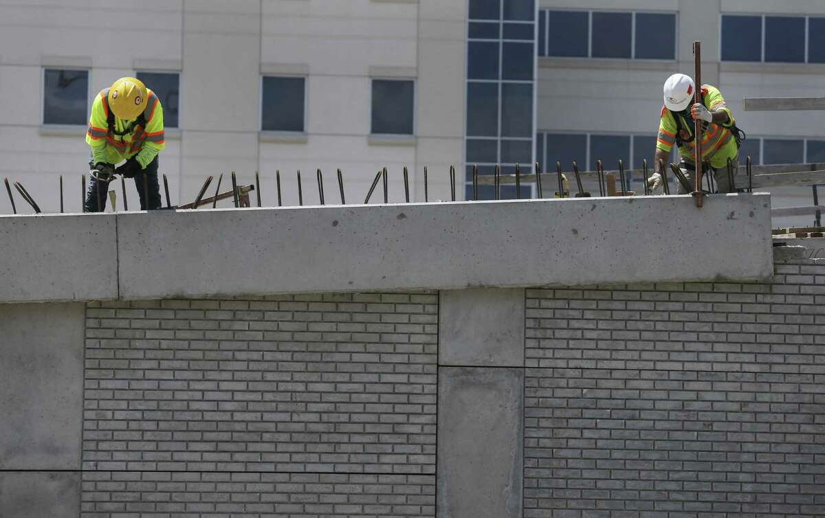 Construction workers tie steel for a barrier on the new ramp south of the Loop 610 interchange with Interstate 69 on April 22. Highway projects, notably interchange rebuilding, is a centerpiece of upcoming transportation spending.