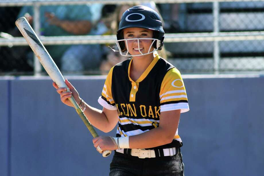 Klein Oak 2nd baseman Allie Saville is all smiles as she looks to Coach Barry Wilson for a sign during her at-bat in the top of the third inning against Klein in their District 15-6A play-in game at Klein Cain High School on April 19, 2019. Photo: Jerry Baker, Contributor / Houston Chronicle