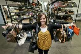 Taken in 2013, Sarah Davis, co-owner of Fashionphile.com, posed with her bags in a company warehouse in the Carlsbad, Calif. The Internet company sells rare, vintage, and discontinued previous owned bags.