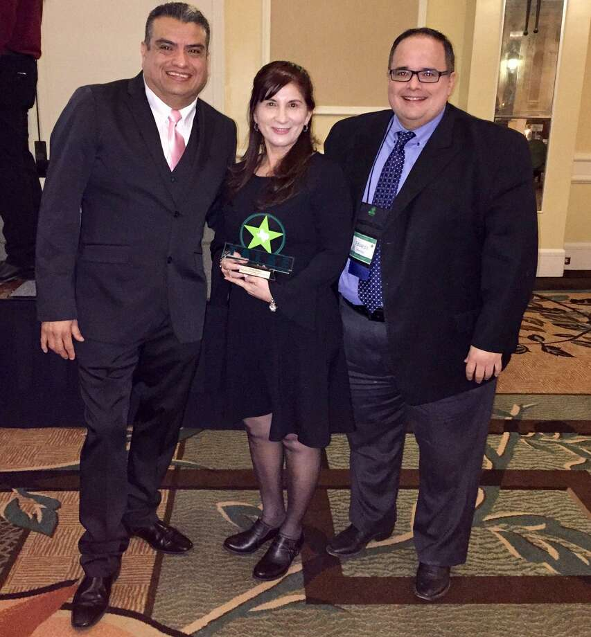 Olivia Ramos proudly accepts the Support Person of the Year Award at the annual Texas Association for Literacy and Adult Education conference. Photo: Courtesy Photo