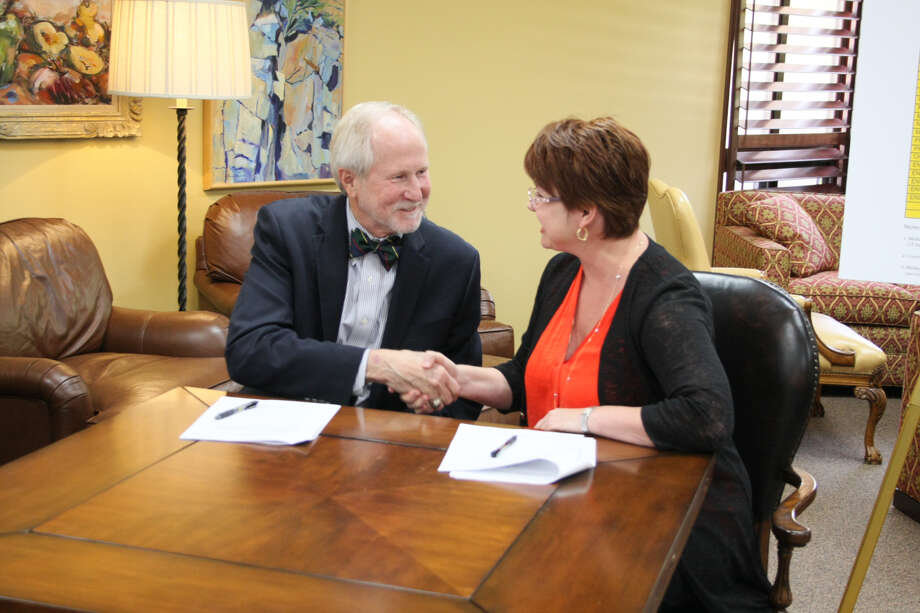 Midland College President Steve Thomas and University of Texas of the Permian Basin President Sandra Woodley shake hands after signing an agreement to collaborate on an academic pathway for engineering students, allowing the transfer of credits between the two schools. Photo: Courtesy Of Midland College