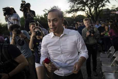 Julián Castro, a candidate for the Democratic presidential nomination, carries a rose given to him by a supporter as he leaves a rally at Hemisfair Park in San Antonio April 10. His campaign should be measured with different yardstick.