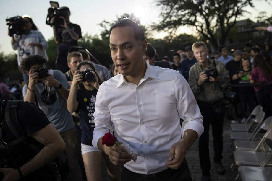 Julián Castro, a candidate for the Democratic presidential nomination, carries a rose given to him by a supporter as he leaves a rally at Hemisfair Park in San Antonio April 10. His campaign should be measured with different yardstick. Photo: Tamir Kalifa/NYT / NYTNS\