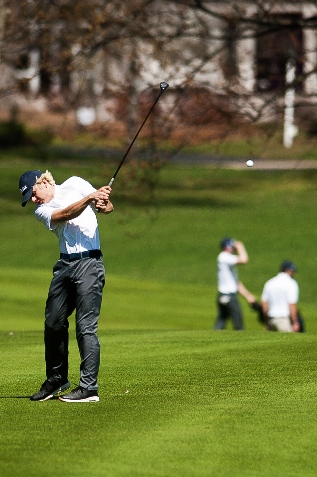 Midland's David Draves competes in a match against Dow on Monday, April 22, 2019 at the Midland Country Club. (Katy Kildee/kkildee@mdn.net)