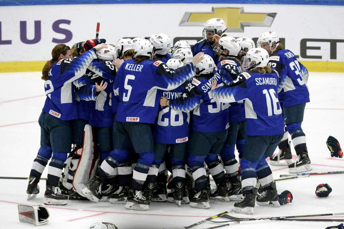 U.S. players celebrate their 2-1 shootout victory over Finland int he IIHF Women's Hockey World Championships gold-medal game on April 14.