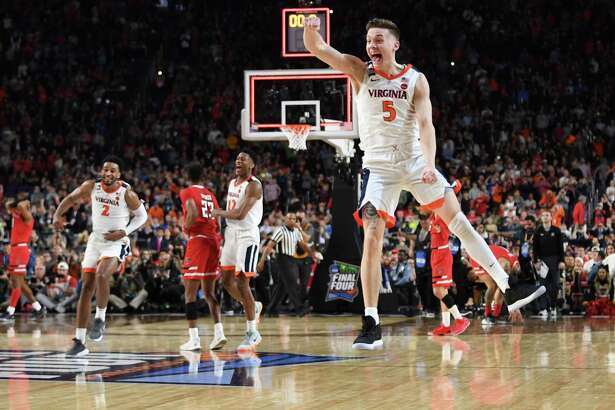 Virginia's Kyle Guy celebrates after winning the NCAA Tournament at U.S. Bank Stadium in Minneapolis on Monday, April 8, 2019. The Cavaliers defeated the Texas Tech Red Raiders 85-77 in overtime.