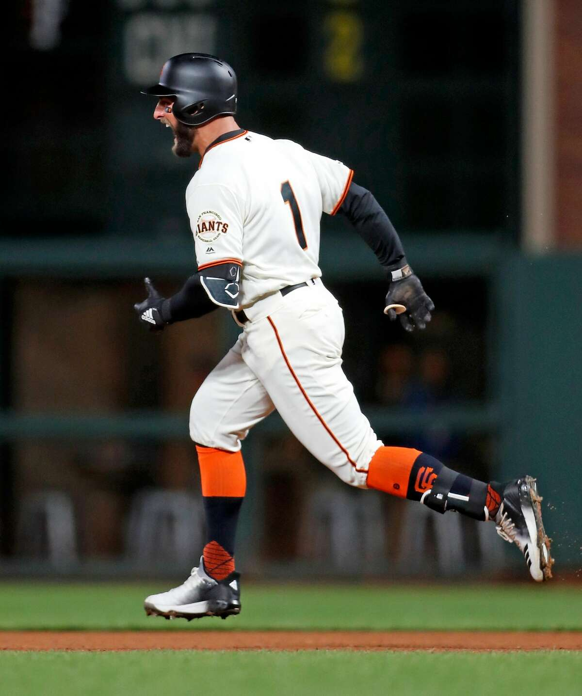 San Francisco Giants' Kevin Pillar reacts as he rounds the bases after hitting solo home run in 7th inning against Colorado Rockies during MLB game at Oracle Park in San Francisco, Calif., on Thursday, April 11, 2019.