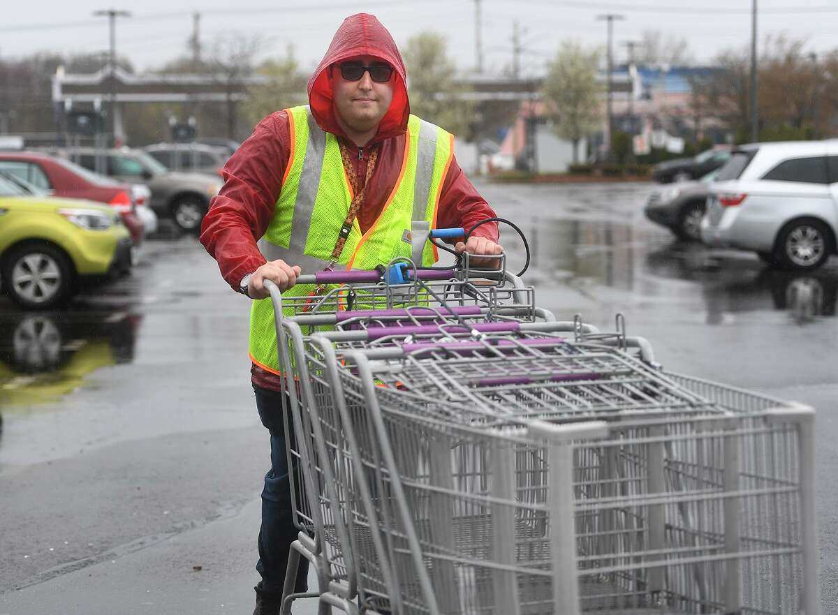 Stop & Shop employee Justin Klein, of Milford, retrieves shopping carts outside the store at 855 Bridgeport Avenue in Milford, Conn. on Monday, April 22, 2019. An 11 day strike by employees ended at the grocery store chain after a tentative agreement was reached on Sunday.
