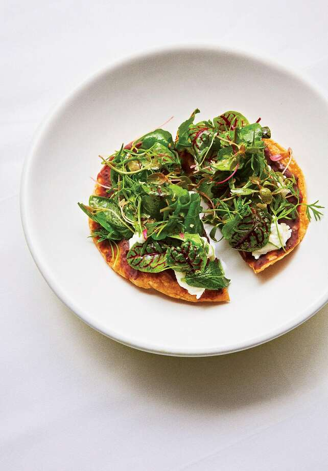 "Gabriela Cámara's Tostadas de Quelites (Tostadas With Wild Greens) from her cookbook ""My Mexico City Kitchen."" Photo: Marcus Nilsson / Lorena Jones Books"