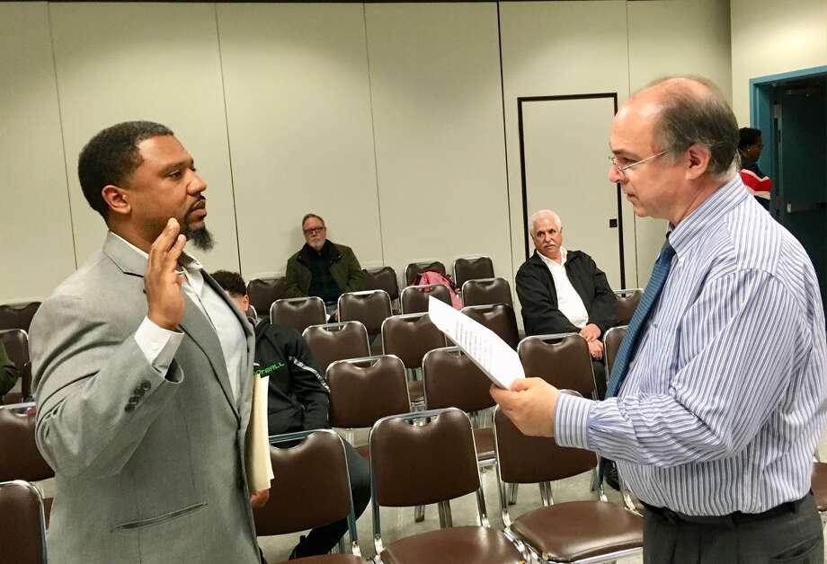 LaMar Kennedy is sworn in as the newest Bridgeport BOE member. April 22, 2019 Photo: Linda Conner Lambeck