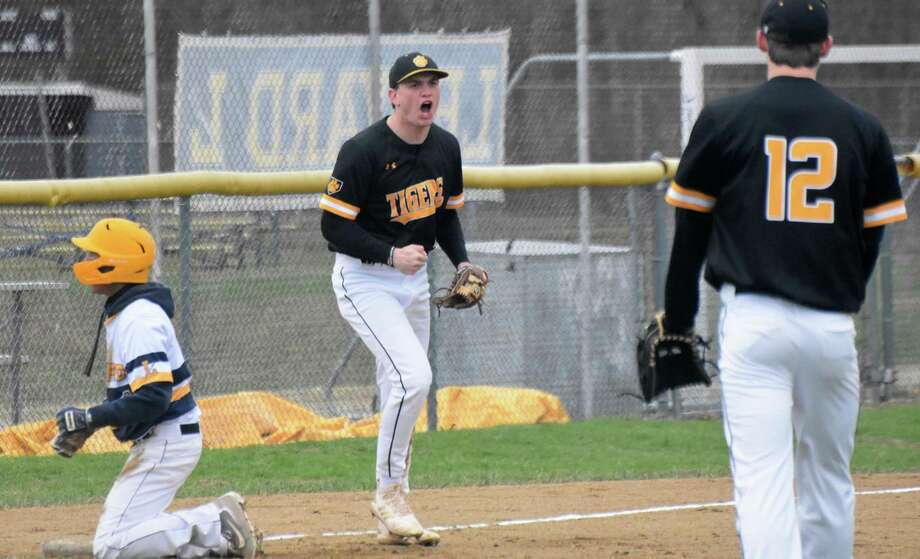 Hand's Phoenix Billings celebrates after tagging out a runner at third base at Ledyard High School on Thursday, April 18, 2019. (Pete Paguaga, Hearst Connecticut Media)