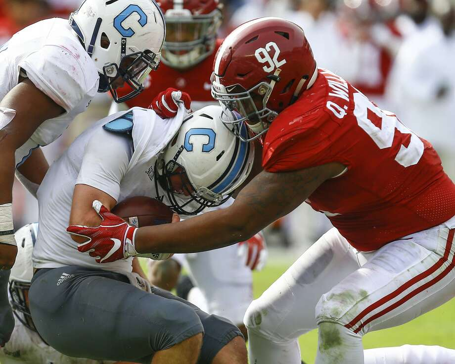 Alabama defensive lineman Quinnen Willliams, a potential early pick by the 49ers, stops Citadel quarterback Brandon Rainey in November. Photo: Butch Dill / Associated Press