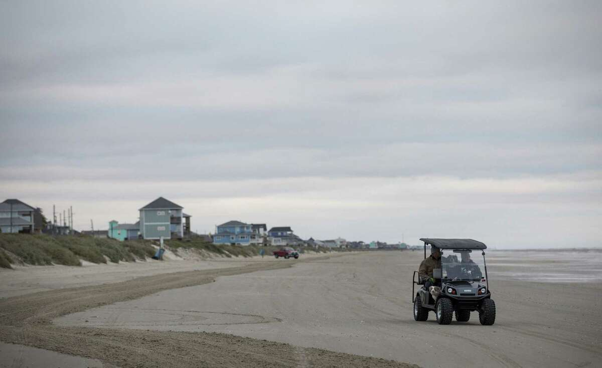 Harry Monceaux and his wife Charlotte Monceaux drive home on the beach, Friday, Dec. 14, 2018, in Crystal Beach. The couple recently bought a piece of property that will be behind the current route of a proposed coastal barrier.