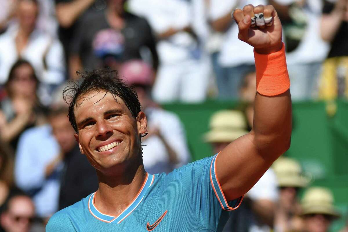 TOPSHOT - Spain's Rafael Nadal celebrates after winning against Spain's Roberto Bautista Agut at then end of their tennis match on the day 5 of the Monte-Carlo ATP Masters Series tournament on April 17, 2019 in Monaco. (Photo by Yann COATSALIOU / AFP)YANN COATSALIOU/AFP/Getty Images