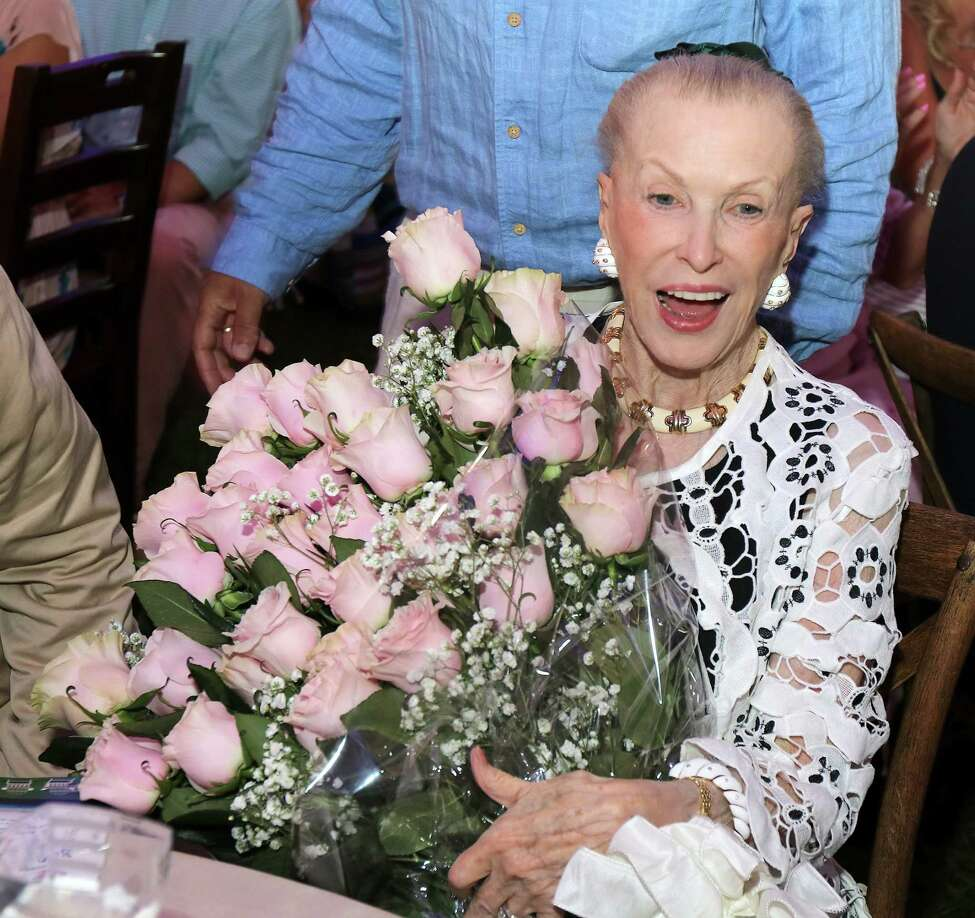 Saratoga Springs, NY - August 2, 2017 - (Photo by Joe Putrock/Special to the Times Union) - Philanthropist Marylou Whitney was presented with dozens of roses, each representing a year of support for Saratoga Hospital, during the Saratoga Hospital Foundation?s 35th Annual Summer Gala and Benefit Auction at Polo Meadows at the Saratoga Casino and Raceway. ORG XMIT: 09