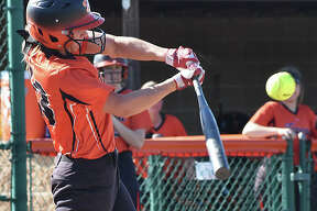 Edwardsville third baseman Lexi Gorniak connects with a pitch during her first-inning at-bat against Calhoun on Monday inside the District 7 Sports Complex.