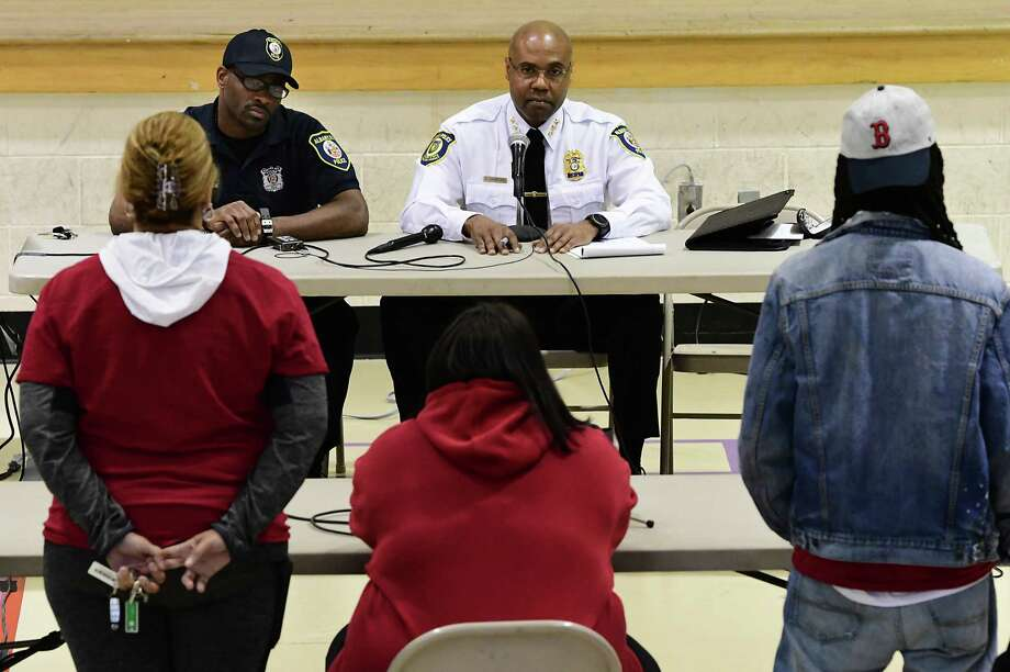 Amy Jones of Abany, sitting in center, expresses her concerns to Police Chief Eric Hawkins during a community meeting focusing on allegations police brutalized residents of First Street after being called to address complaints about noise on Monday, April 22, 2019 in Albany, N.Y. (Lori Van Buren/Times Union) Photo: Lori Van Buren, Albany Times Union / 40046742A